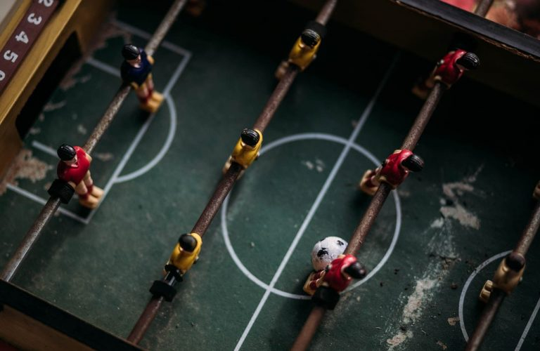 close-up-and-top-photography-of-football-table-2306898